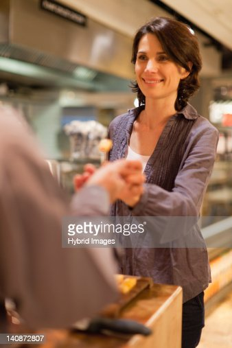 Woman with free samples in grocery store