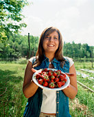 Woman with fresh strawberries