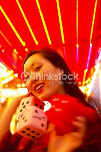 Woman With Fuzzy Dice Las Vegas Nevada Stock Photo Thinkstock