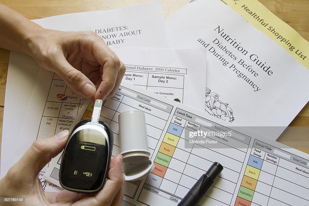 Woman with gestational diabetes testing glucose