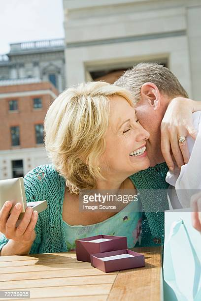 Woman with gift from husband