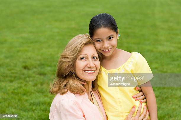 Woman with girl in park