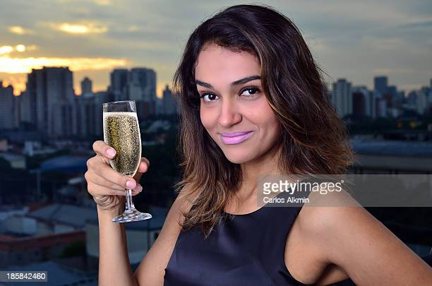 Woman with glass of sparkling wine and SP skyline