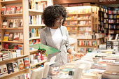 African woman working at her own bookstore