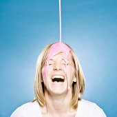woman with goo pouring on her head