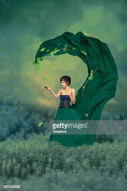 Woman with green sprout in hand