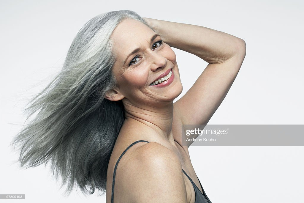 Woman with grey hair and big smile, portrait.
