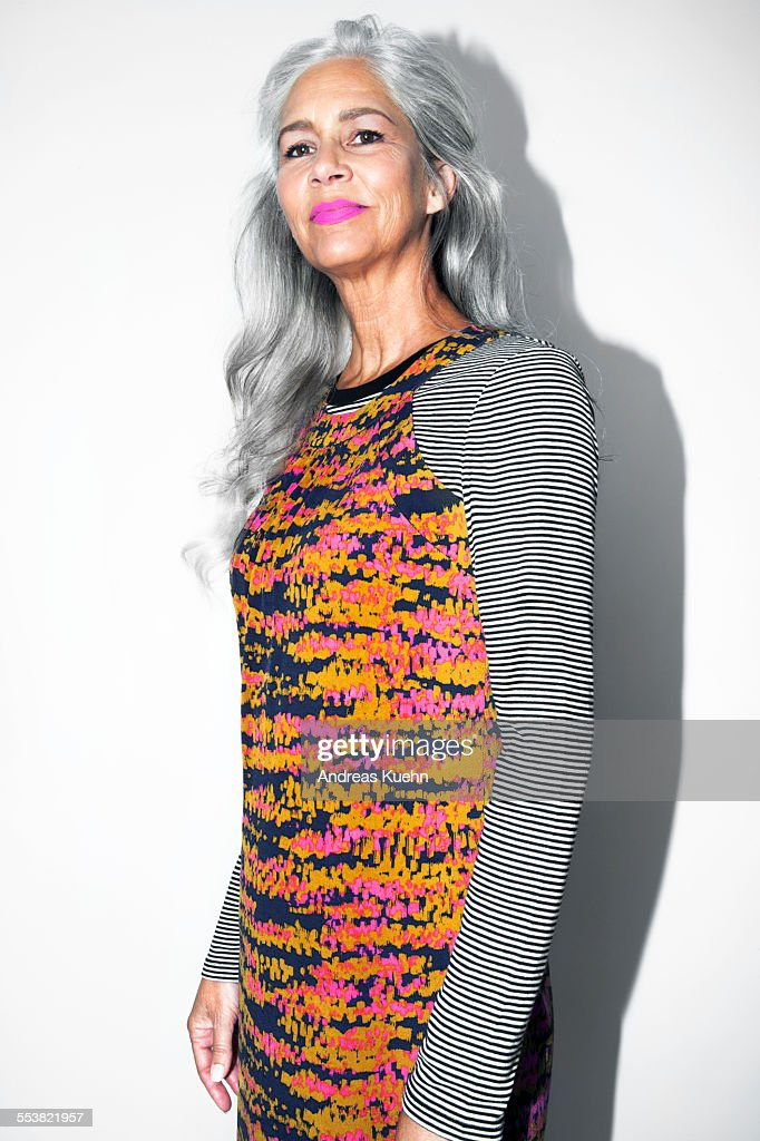 Woman with grey hair and pink lipstick. : Stock Photo