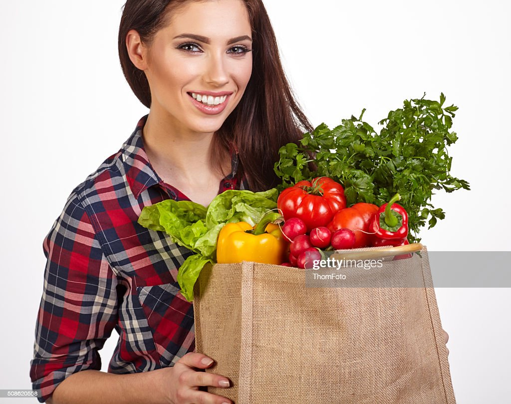 woman with groceries shopping bag full of healthy vegetables smi : Stock Photo