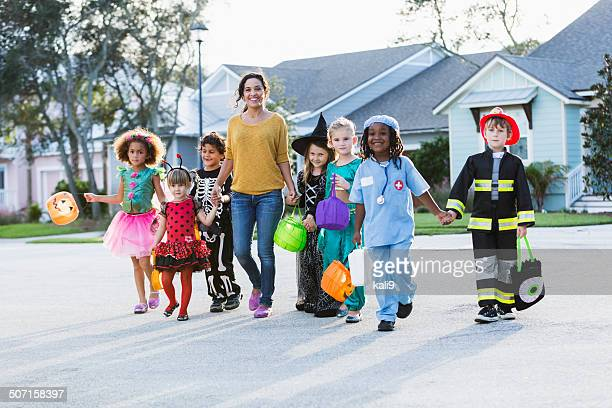 Woman with group of children on halloween