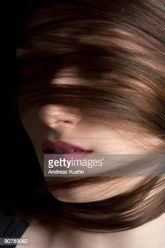 Woman with hair across her face close up. : Foto de stock