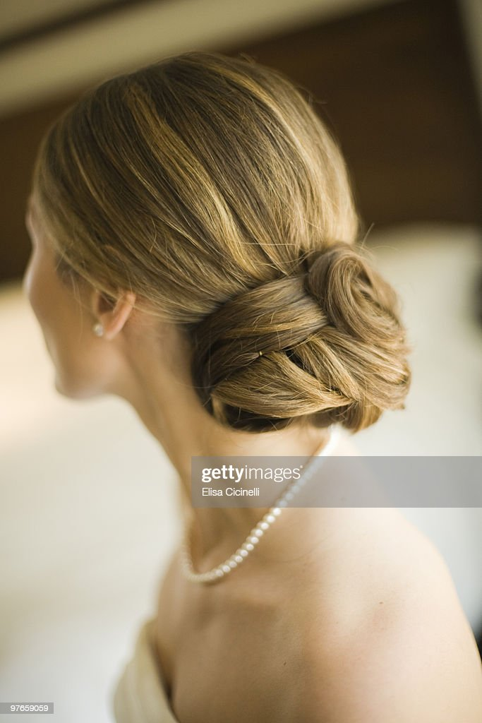Woman with hair and pearls