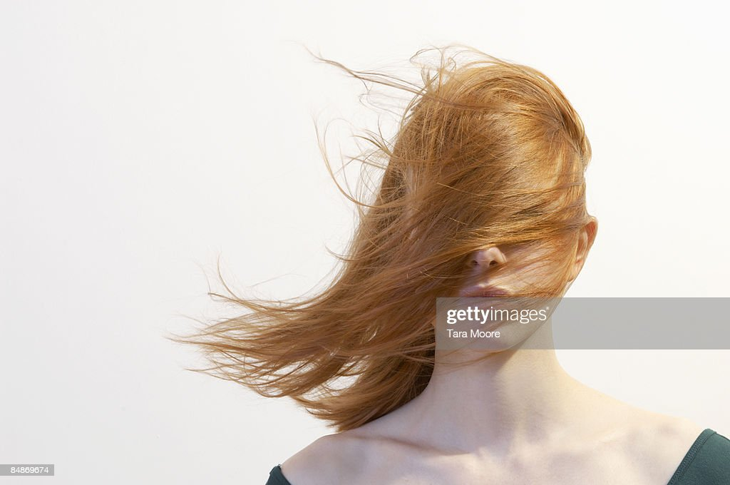 woman with hair blowing over face