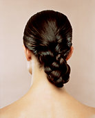 Woman with hair braided, rear view
