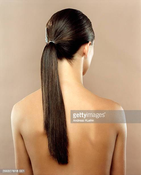 Woman with hair in ponytail, rear view