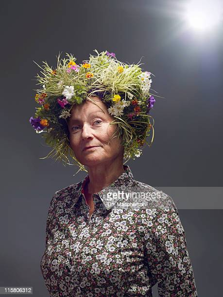 Woman with hair made of plants and flowers