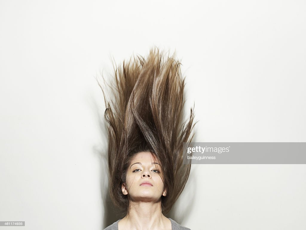 Woman with hair standing up in the air