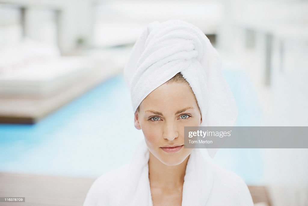 Woman with hair wrapped in towel at poolside : Stock Photo