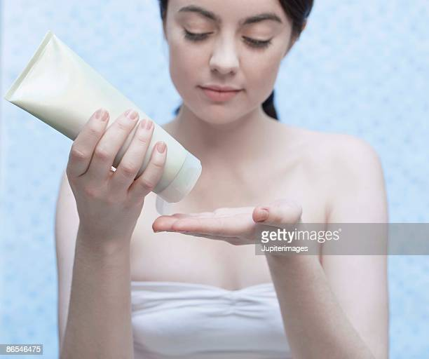 Woman with hand cream