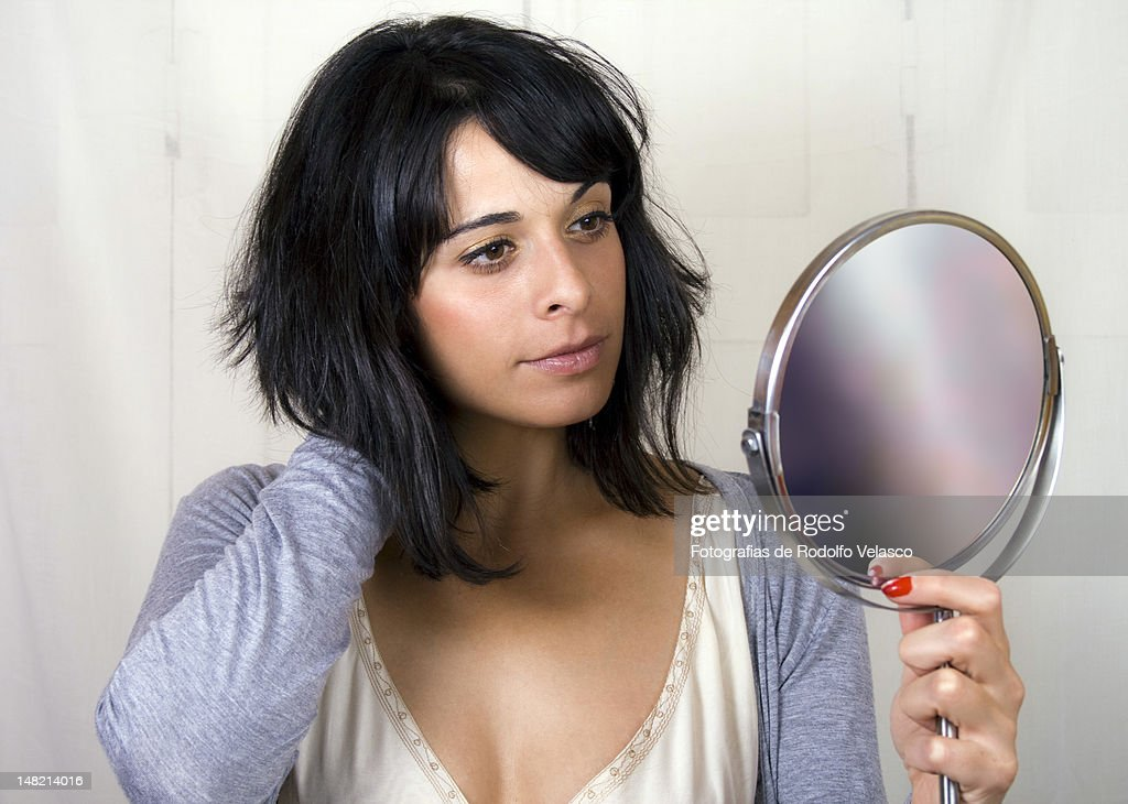 Woman with hand mirror : Stock Photo