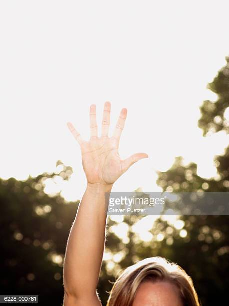 Woman with Hand Raised