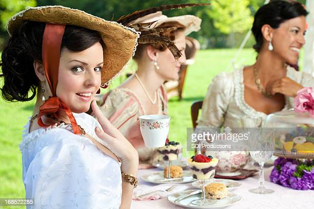 Woman With Hand to Her Face at Victorian Tea Party