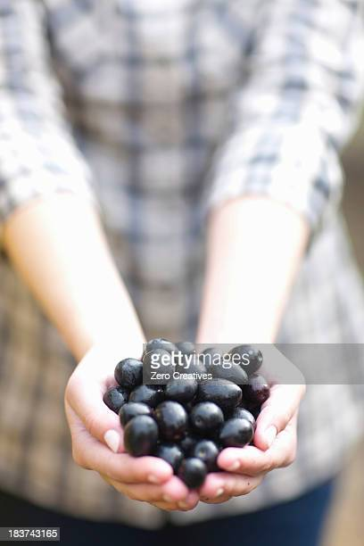 Woman with handfull of olives