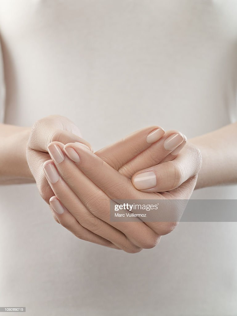Woman with hands cupped, close-up