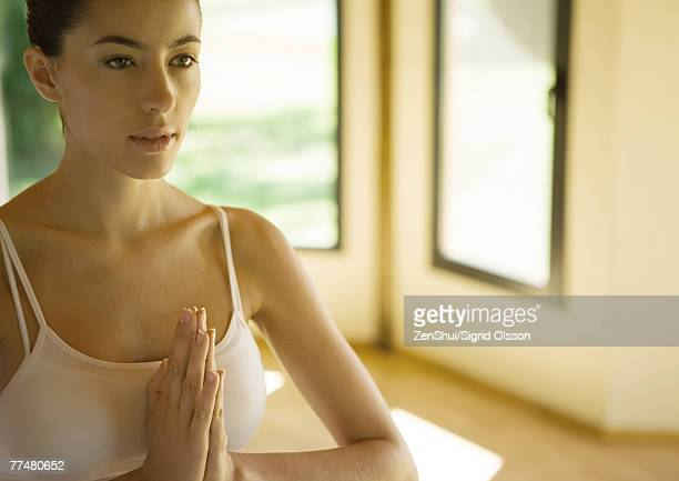 Woman with hands in prayer position