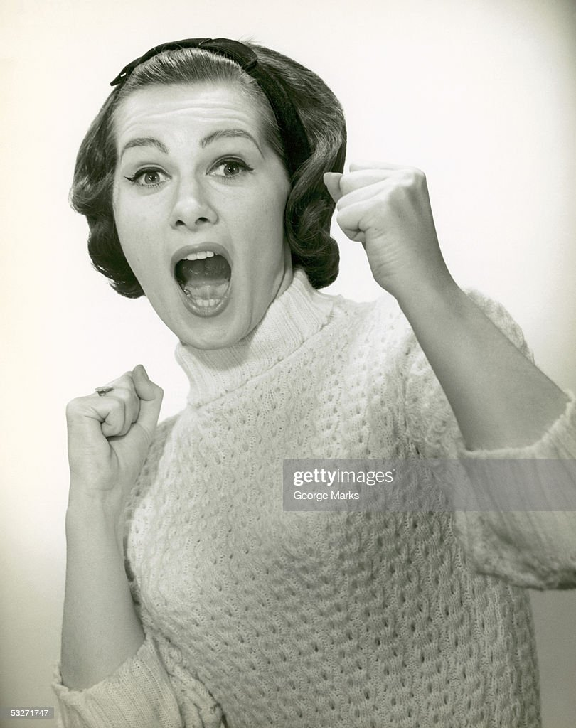 Woman with hands out ready to fight? : Stock Photo