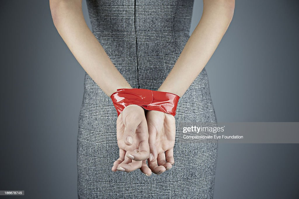 Woman with hands tied behind back