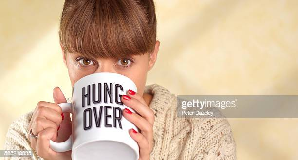 Woman with hangover with coffee