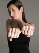 Woman with Hard Work Tattoo on Knuckles