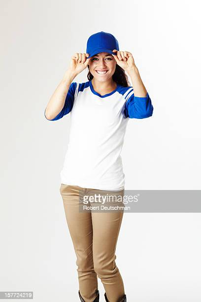 Woman with hat against white background.