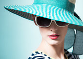 Fashion portrait of female with hat.