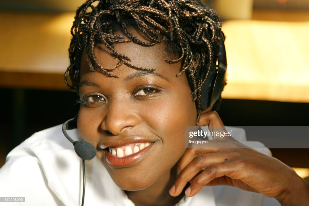 Woman with headset, smiling : Stock Photo