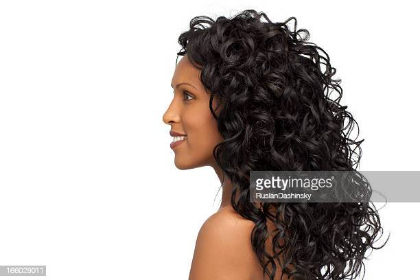 Woman with healthy curly hair.