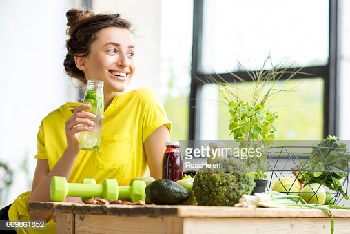 Woman with healthy food indoors : Stock Photo