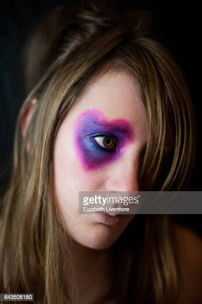 Woman with heart shape around her eye