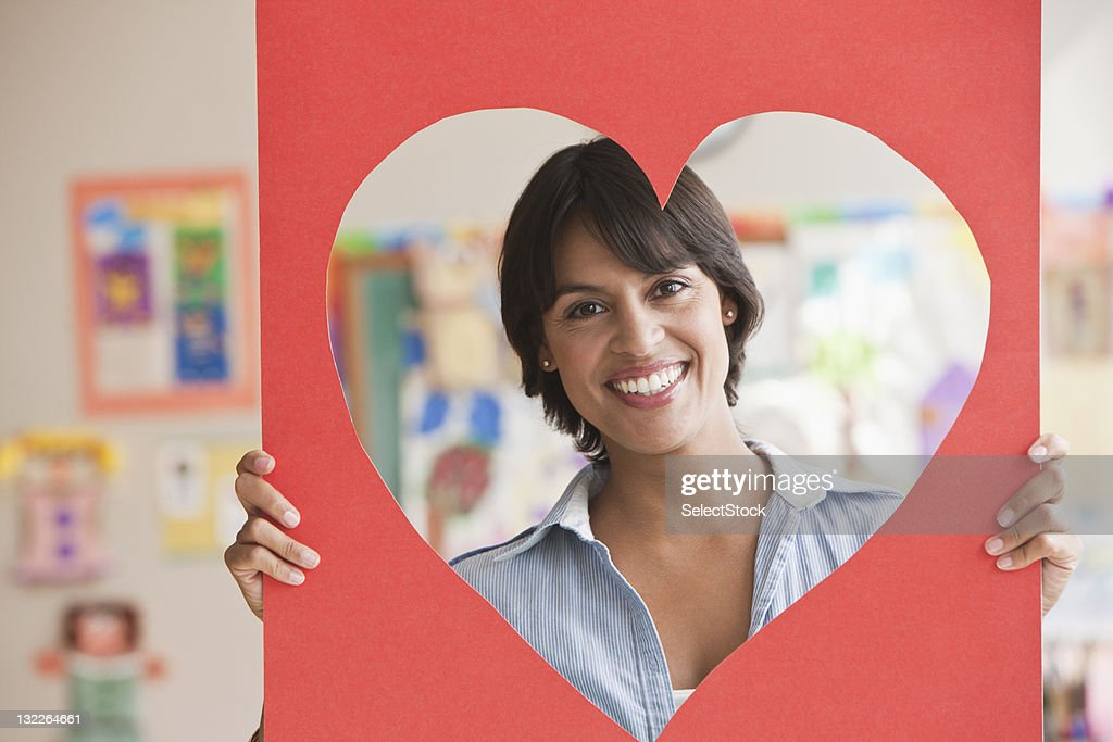 Woman with heart shaped face around her : Stock Photo