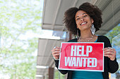 Woman with Help Wanted Sign