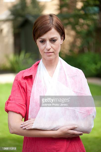 Woman with her arm in a sling