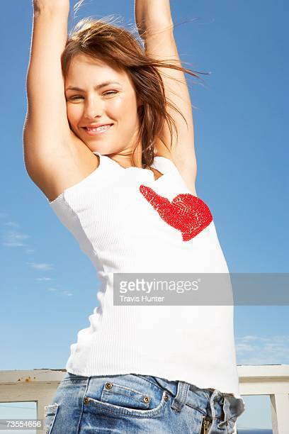 Woman with Her Arms Above Her Head - Posing