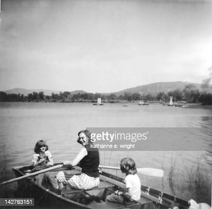 Woman with her children in boat : Stock Photo