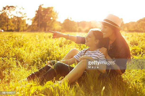 Woman with her daughter enjoying the sun.