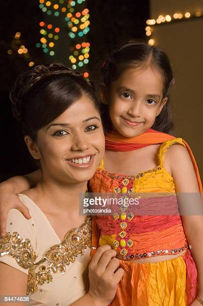 Woman with her daughter smiling