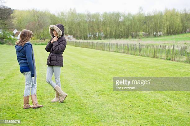 Woman with her daughter standing in a field