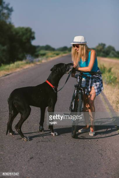 Woman with her dog on the road