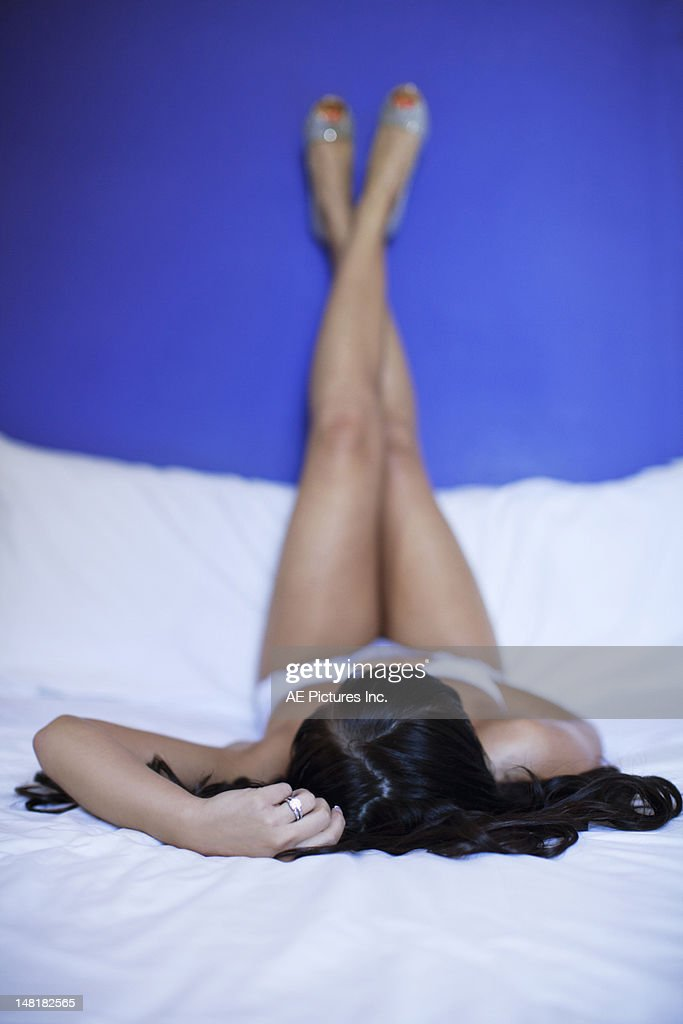 Woman with her feet in the air : Stock Photo