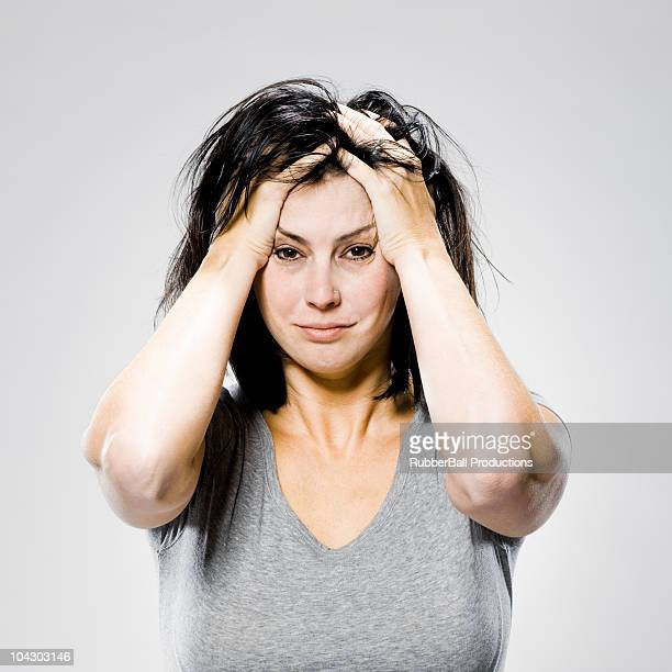 woman with her hands on her head